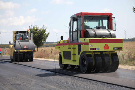 roadwork: Group of heavy vibration roller compactors. Asphalting