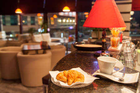 coffeeshop: croissant and coffee cup at coffeeshop