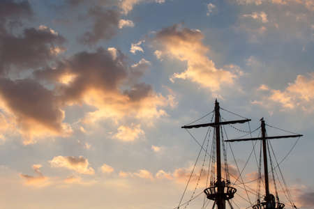 topsail: Masts of a pirate ship on sunset Stock Photo