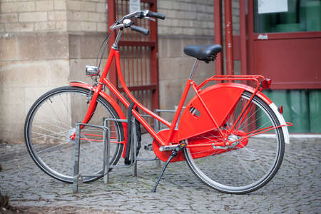 Red bicycle parked in the city
