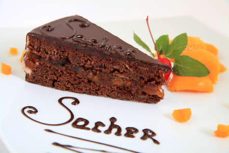 fresh chocolate sacher cake with decoration Standard-Bild