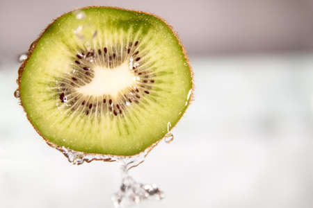 splash of water: water splash on sliced kiwi fruit