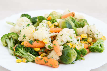 cooked vegetables in white plate Standard-Bild