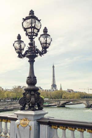 alexandre: Paris view. Bridge of Alexandre III against the Eiffel Tower in Paris, France.