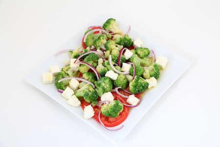 broccoli salad: Broccoli salad with tomatoes and cheese