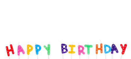 Colorful candles in letters saying Happy Birthday, isolated on white background photo