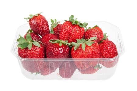 Fresh strawberries in plastic box, isolated on white photo