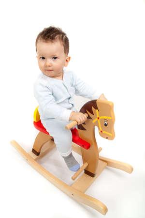 rocking: little boy on a rocking horse.