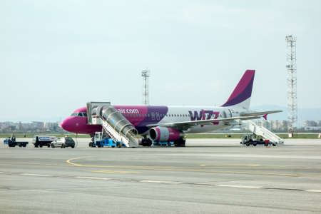 flight crew: Sofia , Bulgaria - APRIL 13, 2015: Airplane is near the terminal gate ready for takeoff. Crew is preparing the plane for flight. Wizzair is a rapidly growing low-cost carrier based in Hungary.