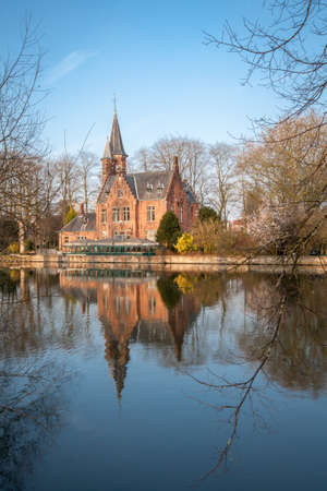 flemish: Medieval building (Castle) on Love lake, Minnewater Park in Bruges, Belgium Stock Photo