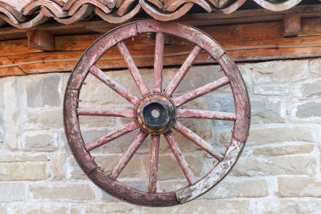 wagon wheel: old wagon wheel on the wall