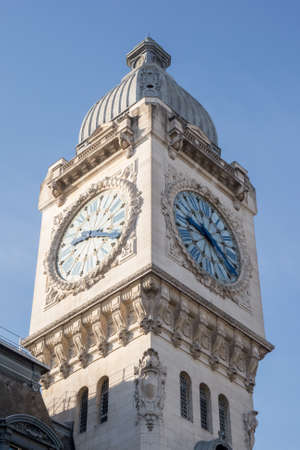 clocktower: Clocktower of famous railway station in Paris, France. Gare de Lyon. Stock Photo