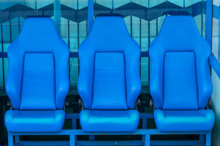 player bench: Empty coach and reserves blue bench on a football stadium