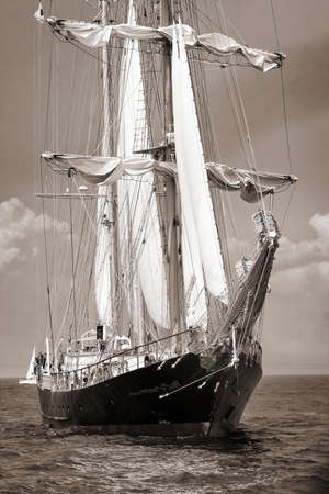 brig ship: Old ship with white sales in black and white Stock Photo
