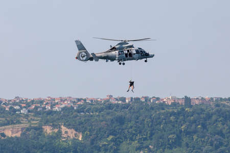 heli: rescue operation by Navy helicopter