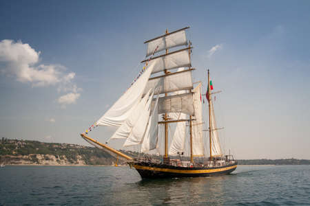 old ship: Old ship with white sales, sailing in the sea