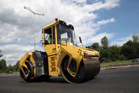 vibroroller: Large road-roller paving a road. Road construction