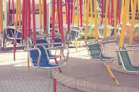 playground equipment: Empty swing on children playground
