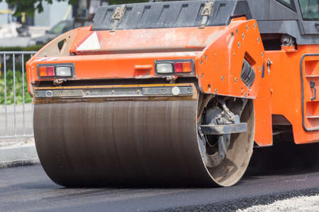 construction vibroroller: Heavy Vibration roller compactor at asphalt pavement works for road repairing Stock Photo