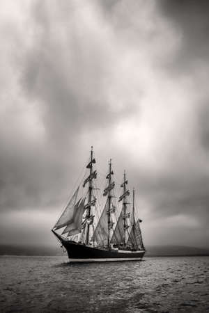brig: Old ship with white sales in black and white Stock Photo