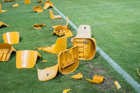 broken plastic seats after match on stadium