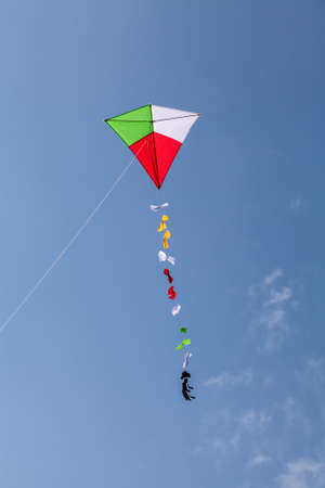 colorful kite flying in a beautiful blue sky Standard-Bild