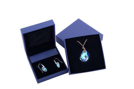 personal ornaments: blue stone pendant and earring in blue present box isolated Stock Photo
