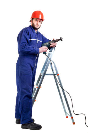 independent contractor: Man with drill standing on ladder