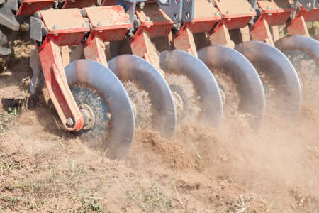 harrow: Close up of a disc harrow system, cultivate the soil Stock Photo