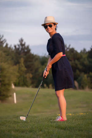 woman golf: young woman, amateur, playing golf Stock Photo
