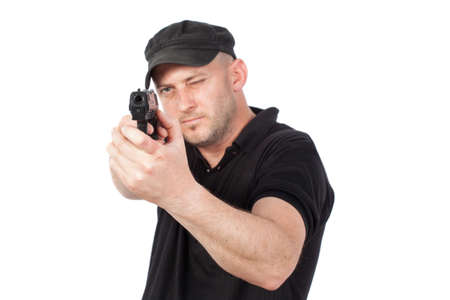 aiming: Man pointing gun, isolated on white. Focus on the gun