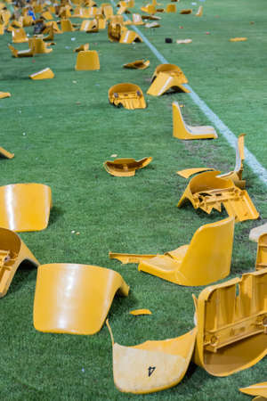 ultras: broken plastic seats after match on stadium