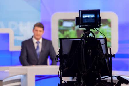 newsreader: tv studio camera recording male reporter or anchorman. Live broadcasting