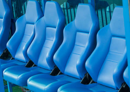 reserves: Empty coach and reserves blue bench on a football stadium