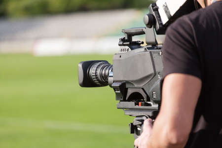 Tv camera broadcasting during a football (soccer) match Stock Photo