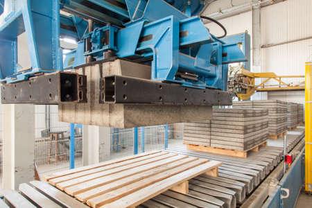 conveyor rail: Modern equipment at factory. Process of producing concrete blocks Stock Photo