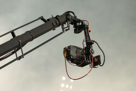 mach: TV camera on a crane on football mach or concert