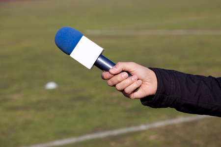 belonging to the caucasoid race: hand hold microphone for interview Stock Photo