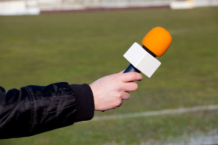 caucasoid race: hand hold microphone for interview Stock Photo
