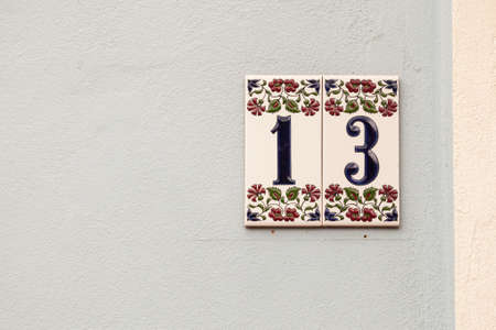 house number thirteen, sign at the wall