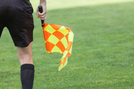 Assistant referees in action during a soccer match Stock Photo