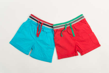 boardshorts: Blue and red shorts for swimming for men or children