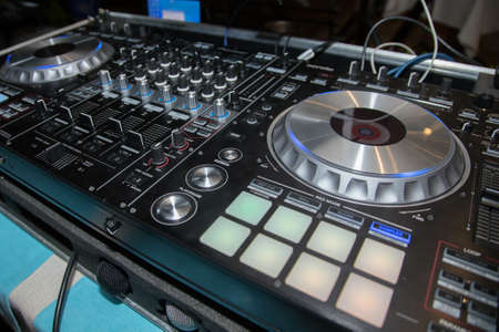 audio mixer: DJ console, CD player and mixer in nightclub