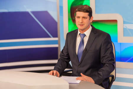 Male anchorman in tv studio. Live broadcasting