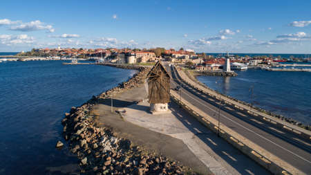 Old windmill at the entrance to the Old Town of Nessebar, ancient city on the Black Sea coast of Bulgaria. ?erial view. Standard-Bild