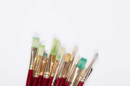 Various drawing tools, set of dirty paint brushes