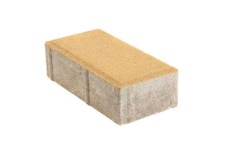 Singolo mattone giallo della pavimentazione, isolato. Blocco di cemento per pavimentazione