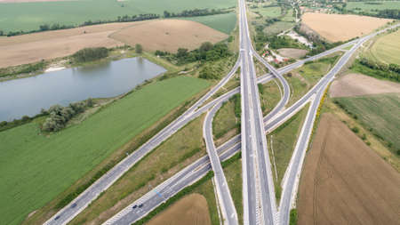 Aerial view of highway and overpass. Road junction, highway intersection