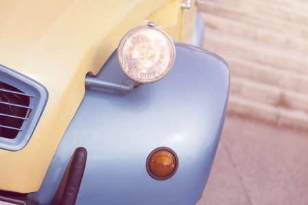 Detail of a vintage car. Close up of headlight retro classic car. Vintage effect style pictures. Classic car.