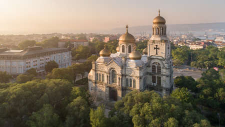 Aerial view of the Cathedral of the Assumption on sunrise, Varna Bulgaria. Byzantine style church with golden domes. Varna is the sea capital of Bulgaria. Stock Photo